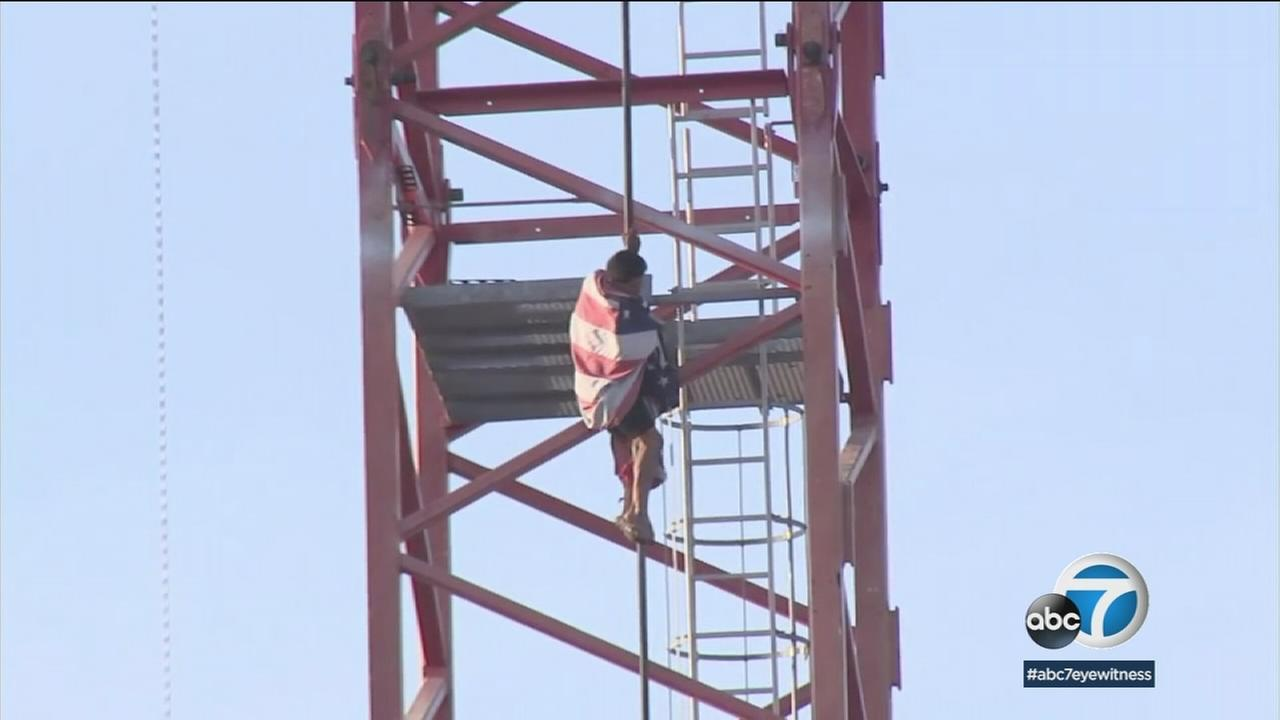 A man who climbed a 200-foot crane at a construction site in Hollywood was undergoing a mental evaluation after surrendering to police without incident.