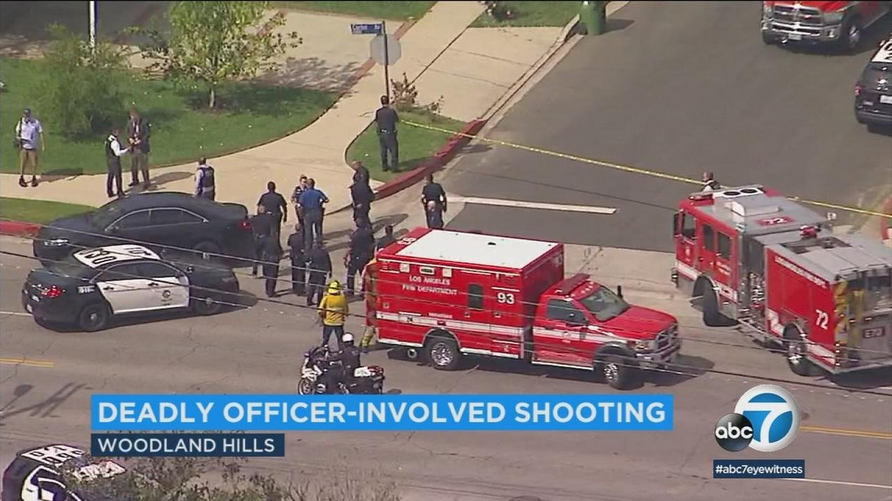 Two officers were injured and a suspect is dead following an officer-involved shooting in Woodland Hills on Monday.