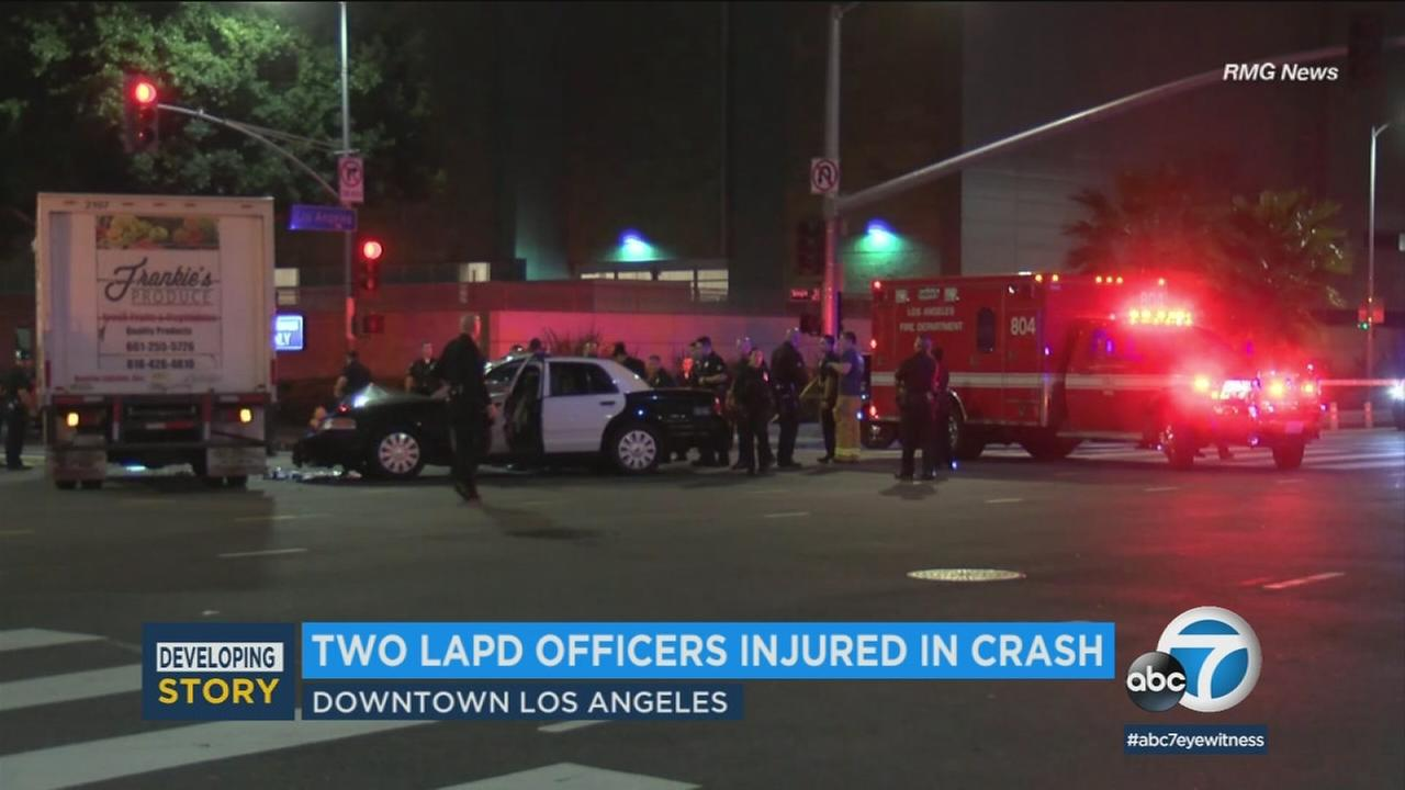 Authorities at the scene of a crash in downtown L.A. that left two LAPD officers injured on Tuesday, April 10, 2018.
