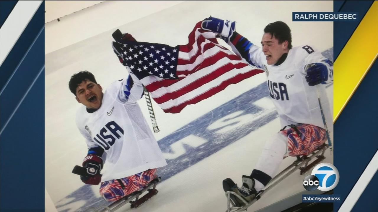 Ralph DeQuebec (left), who lost his legs defusing bombs for the Marines, was honored after helping bring home the gold for Team USA in sled hockey.