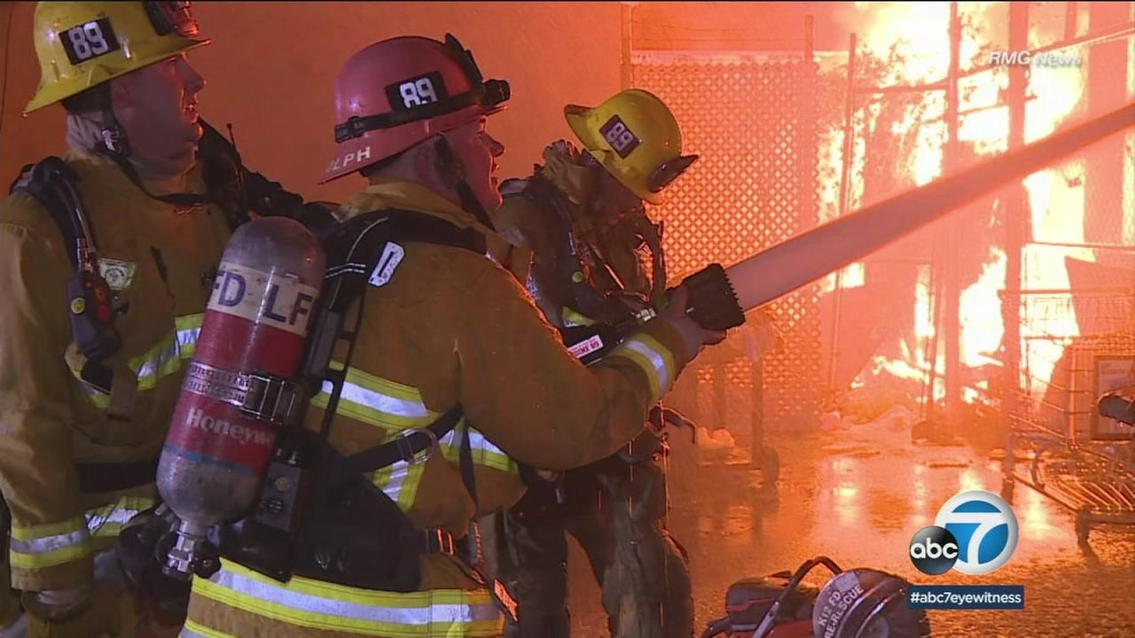 Firefighters battle an apartment fire in North Hollywood on Wednesday, April 11, 2018.
