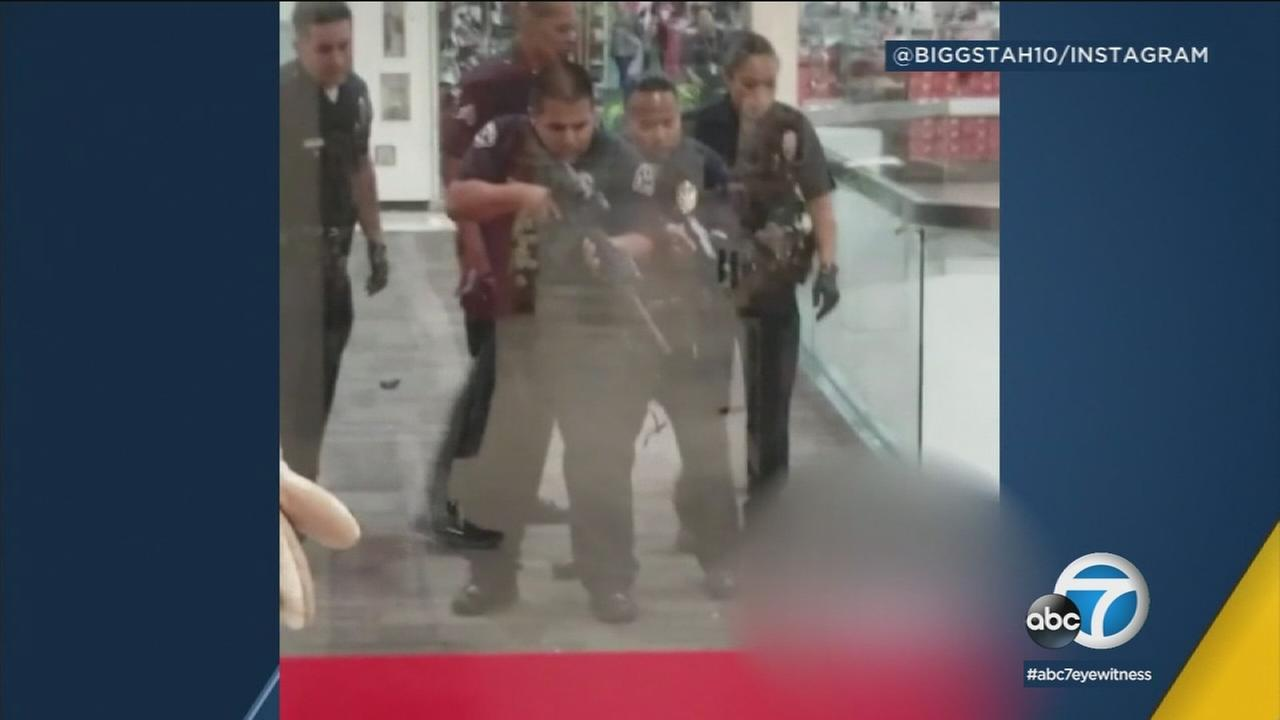 Video shows authorities pointing a gun at a knife-wielding suspect inside a Baldwin Hills mall on Tuesday, April 10, 2018.