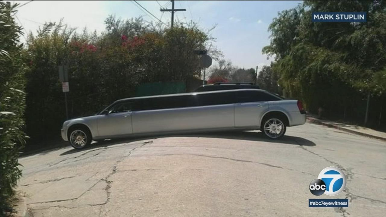 A limo is shown on a very steep road in Echo Park after it was directed there by Waze in order to avoid traffic.