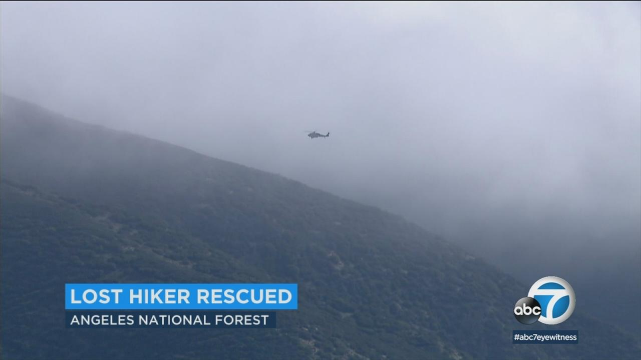 A helicopter is seen above the Angeles National Forest during a search for a lost hiker on Thursday, April 12, 2018.