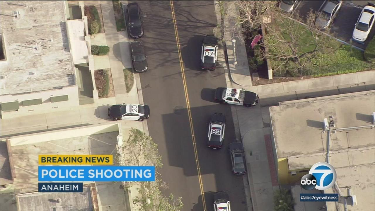 Law enforcement officials are seen in Anaheim, where an officer-involved shooting left a suspect in critical condition.