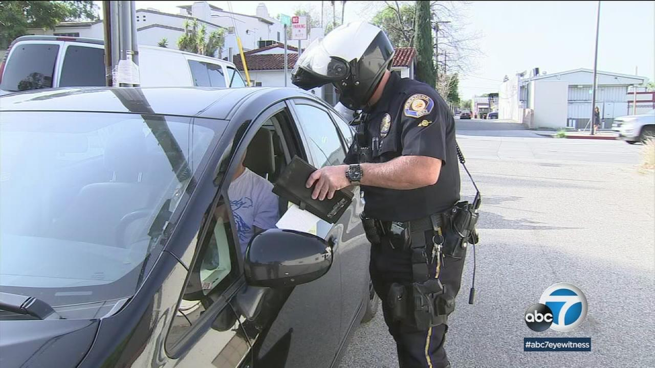 An undated photo of a Pasadena police officer pulling over a driver over distracted driving.