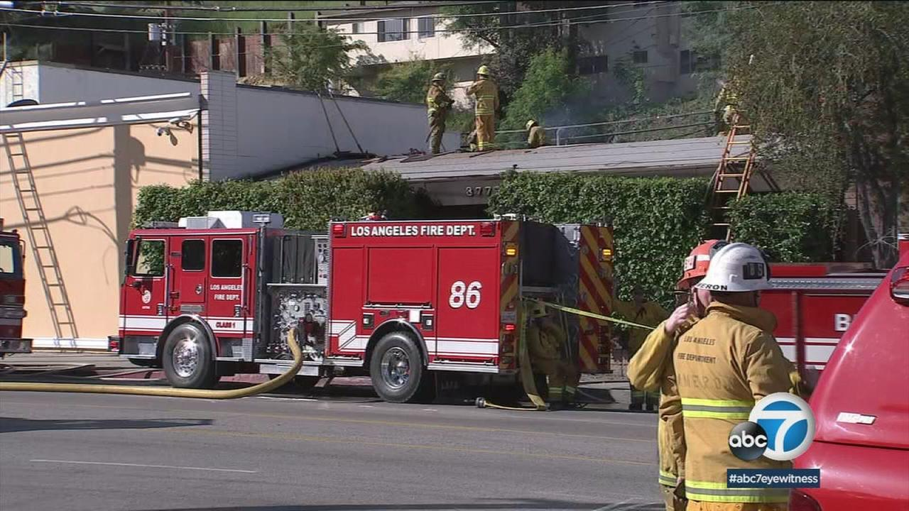 Authorities worked on a fire at a music studio in Studio City that left two dead and two others injured on Saturday, April 14, 2018.