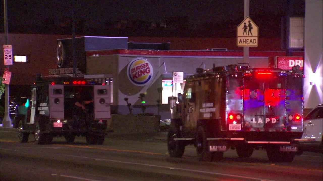 SWAT vehicles arrived at a Jefferson Park Burger King after a possibly armed carjacking suspect was hiding inside the restaurant.