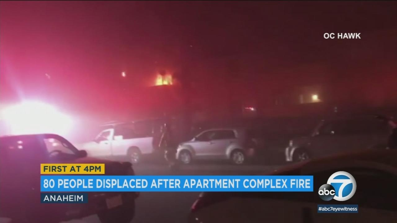 People were jumping off balconies and police were breaking down windows as flames ripped through an Anaheim apartment complex, leaving 80 people without a home.