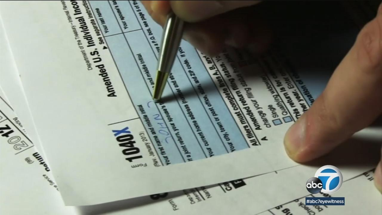 An undated photo of a person filling out a tax form.