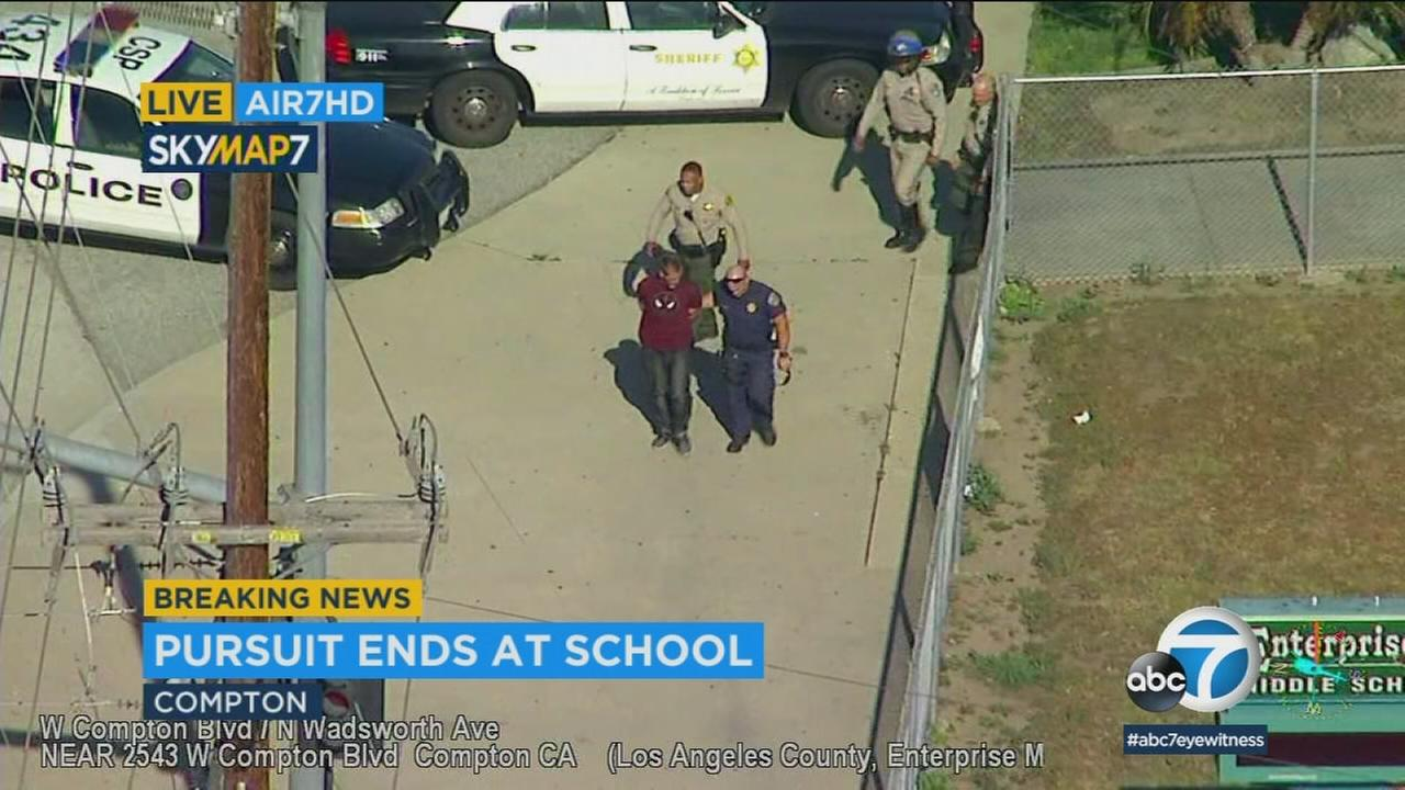 Authorities took a chase suspect into custody after he fled from a U-Haul truck and tried to hide in a school in Compton on Tuesday, April 17, 2018.