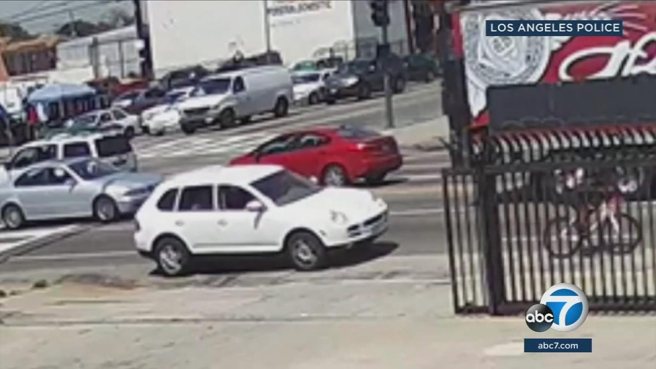 A white Porsche Cayenne is shown in surveillance video moments before the driver struck and killed a cyclist in South L.A. and then fled the scene on Tuesday, April 10, 2018.