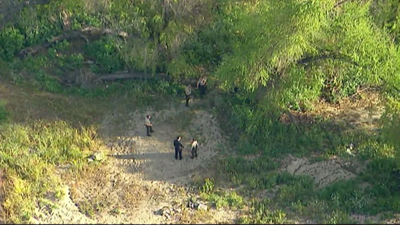 Authorities searched the area for evidence and clues after friends of a teenager found his body near the San Gabriel Riverbed in South El Monte on Wednesday, April 18, 2018.