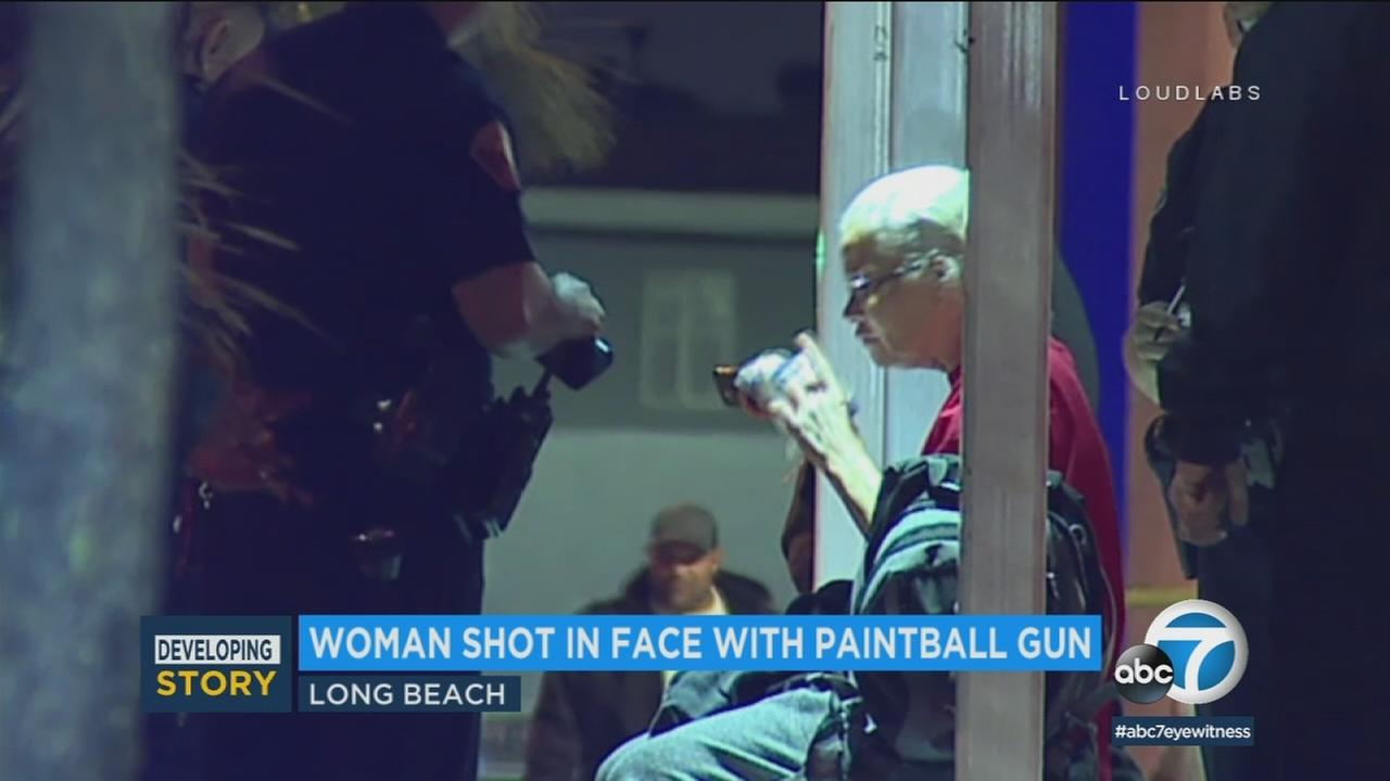 Long Beach police are looking for the person who shot a woman in the face with a paintball gun.
