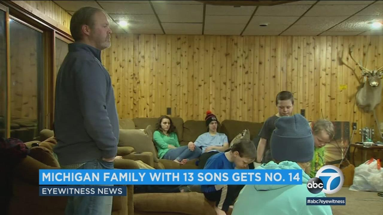 A Michigan couple with 13 sons has welcomed a 14th into the family.