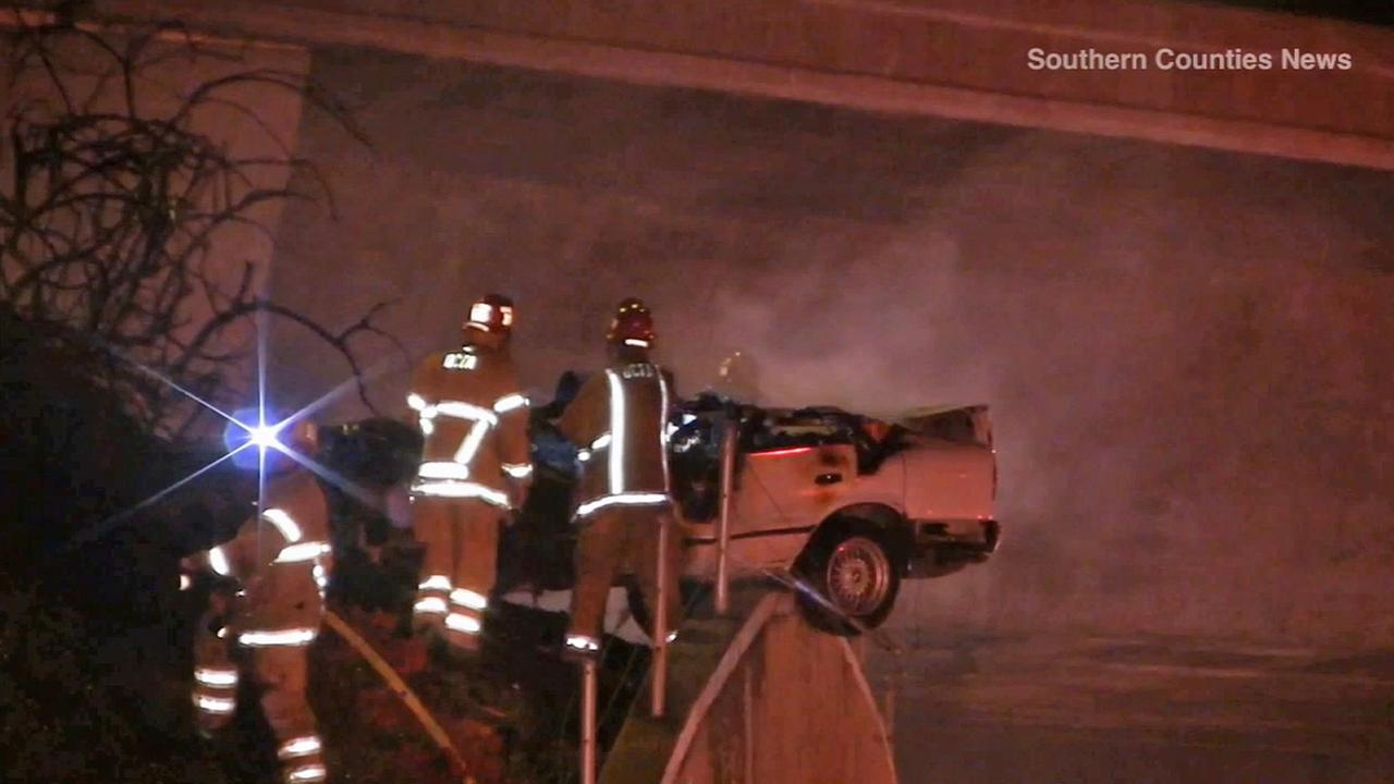 Crews on scene of a car crash in Irvine that left five teens dead on Saturday, Oct. 4, 2014.