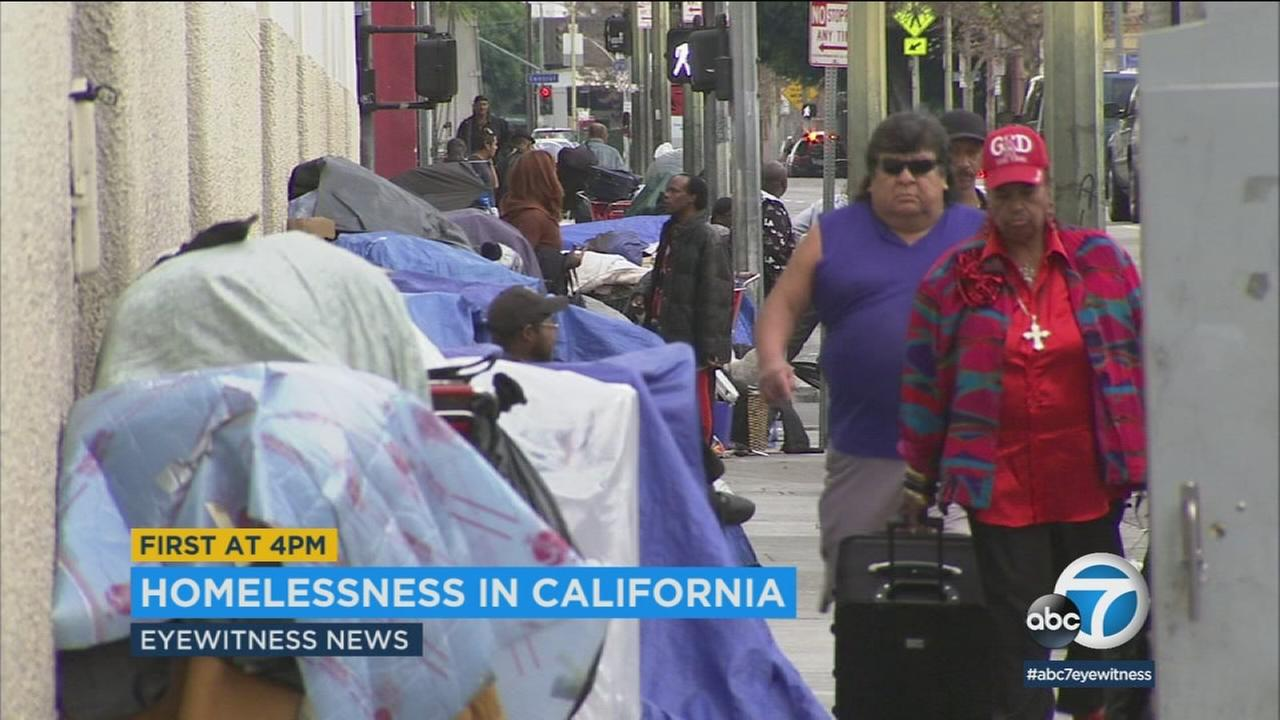 Homeless people are shown on Skid Row in Los Angeles.