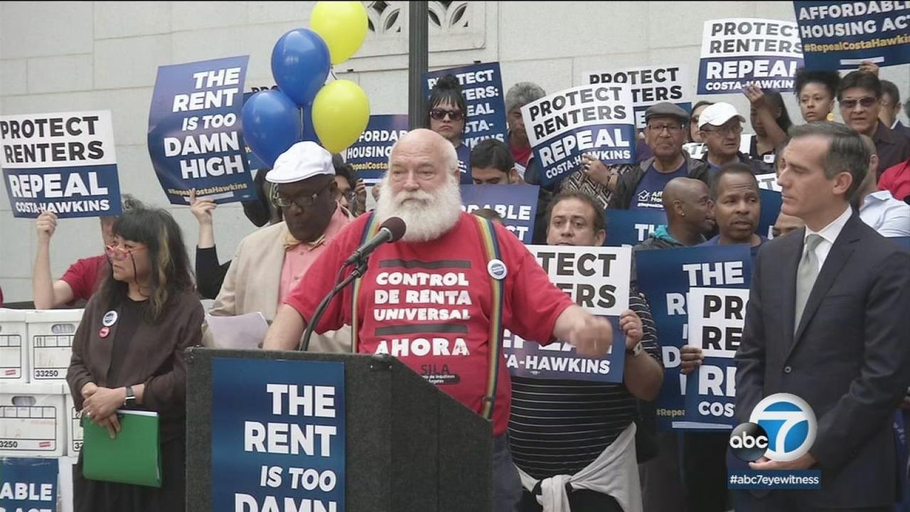 Mayor Eric Garcetti (right) and tenants organizations spoke in favor of a plan to expand rent control in California.