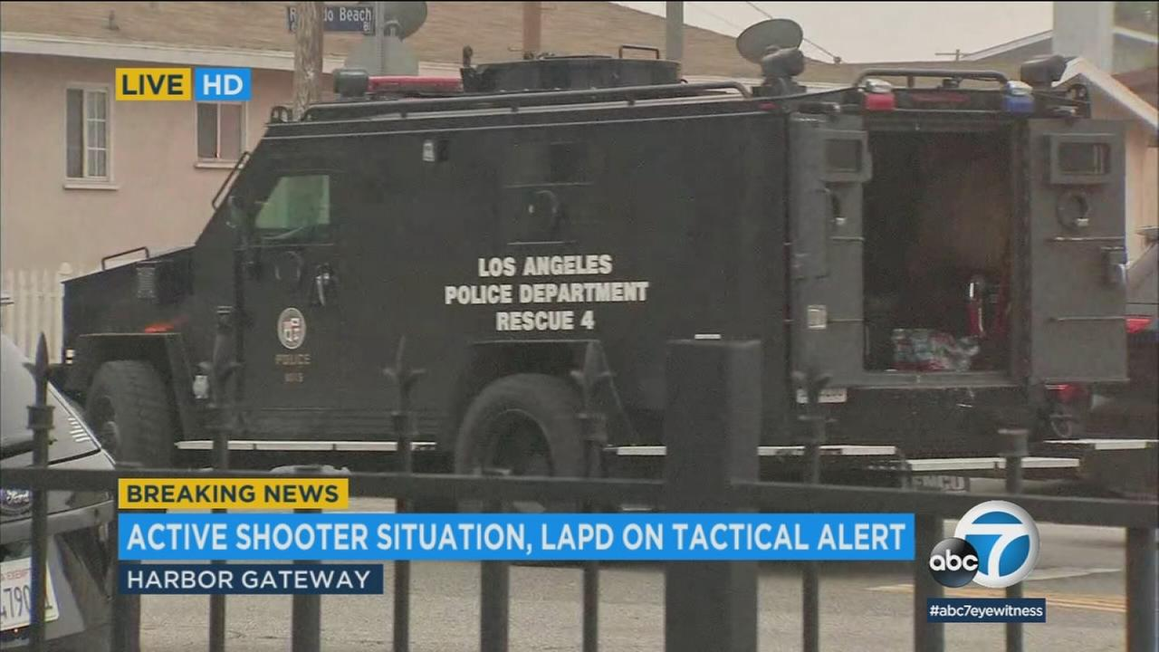 Reports of an active shooter after a structure fire in the Harbor Gateway area Tuesday morning prompted a massive police response.