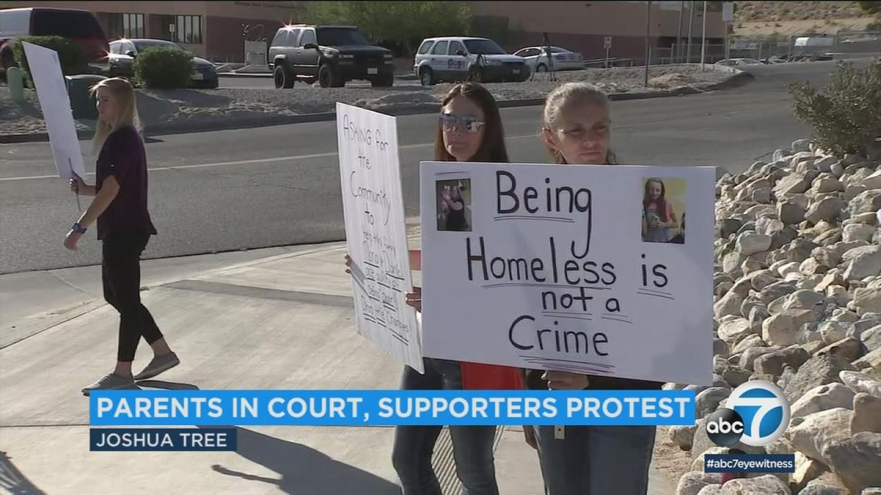 Friends of a Joshua Tree couple accused of child abuse because of squalid living conditions held a rally to support them, saying they are only guilty of being poor.
