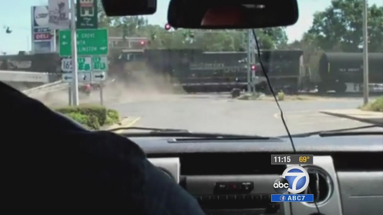 A cellphone camera captured the moment when a freight train crashed into a stalled big rig in Louisiana.