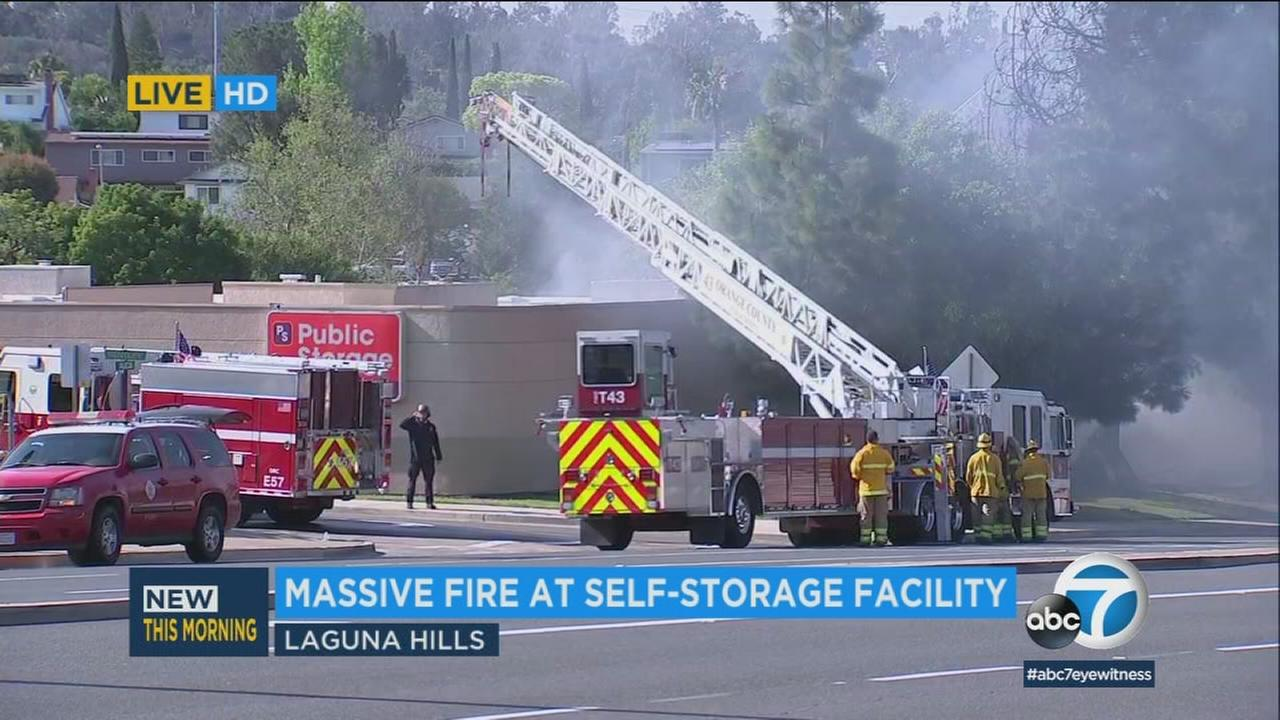Firefighters knock down a fire at a storage facility in Laguna Hills on Sunday, April 29, 2018.