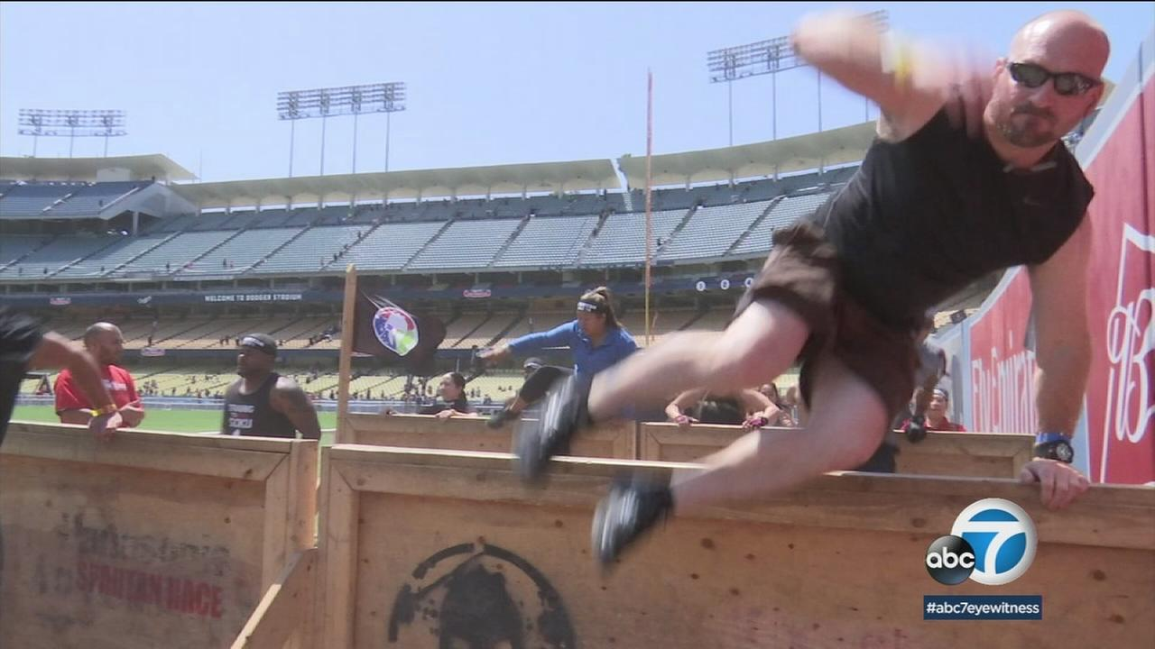 Some 8,000 fitness fanatics came to Dodgers Stadium to run stairs, climb ropes, jump walls and more for the Spartan race.