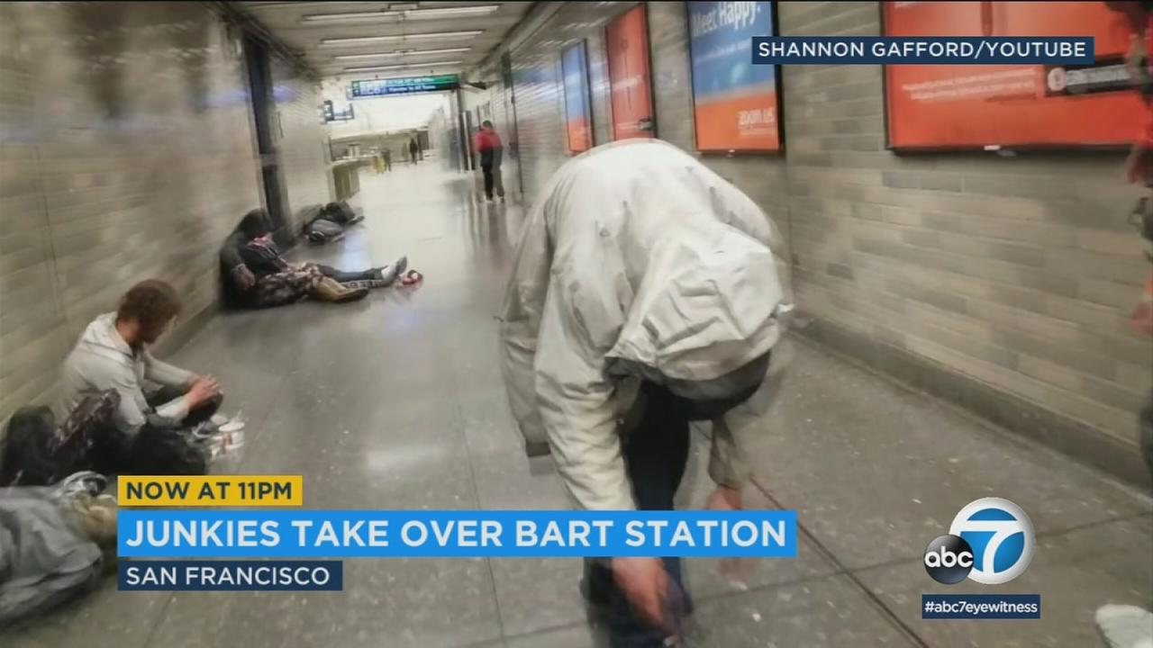 A person who appears zombie-like after he may have done drugs is shown on video as a commuter headed to work by traveling through a BART station.