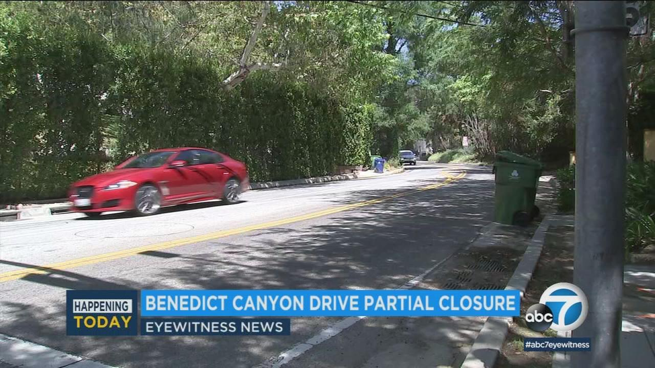 A car travels on Benedict Canyon Drive in this undated photo.