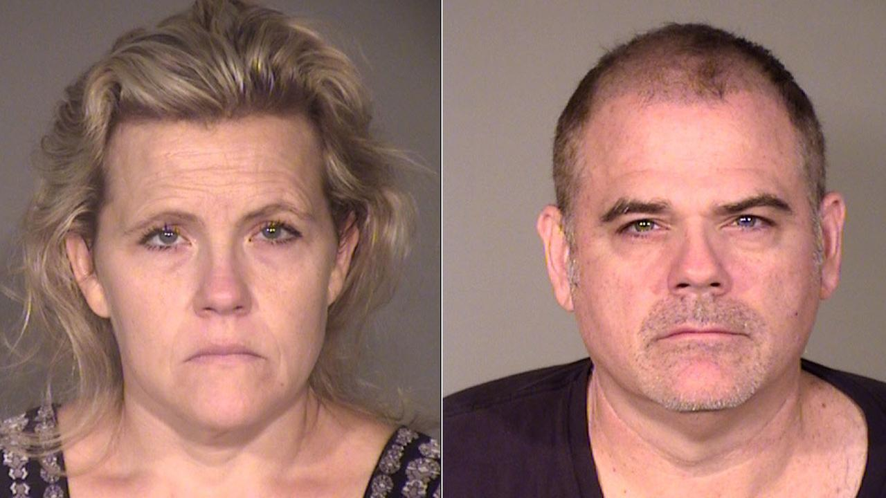 Elizabeth Hooper and her husband David Hooper are shown in mugshots.