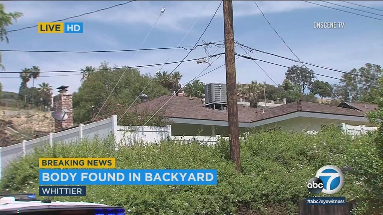 A fence surrounding the backyard of a home where a woman was found dead on Friday, May 4, 2018.