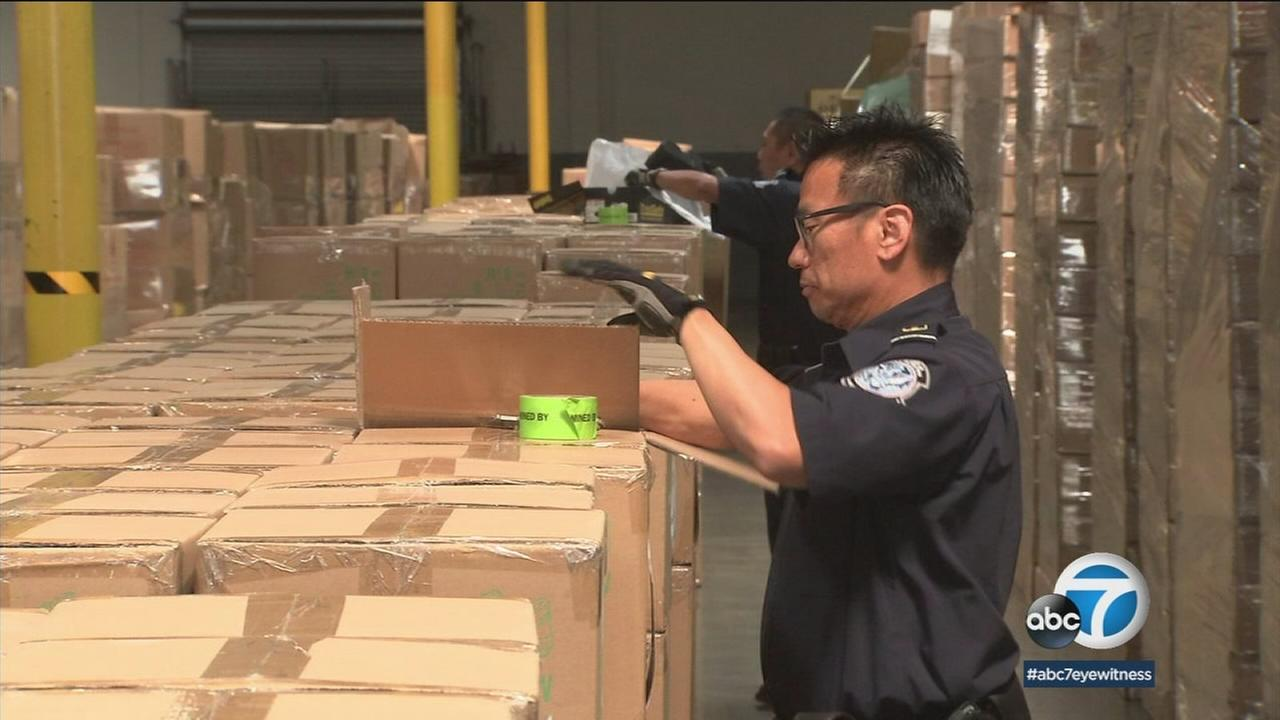 Customs and Border Protection agents sifted through packages at the Port of Los Angeles.