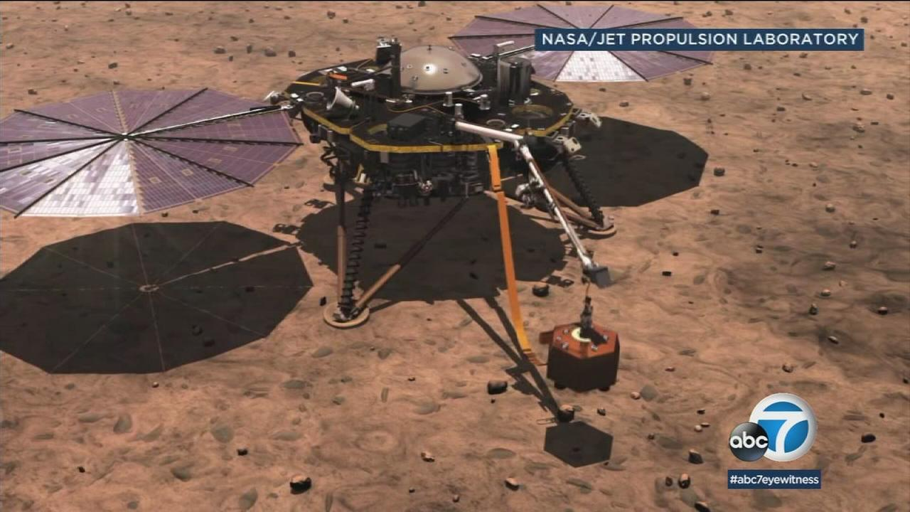A Mars rover is shown in a simulation from NASA.