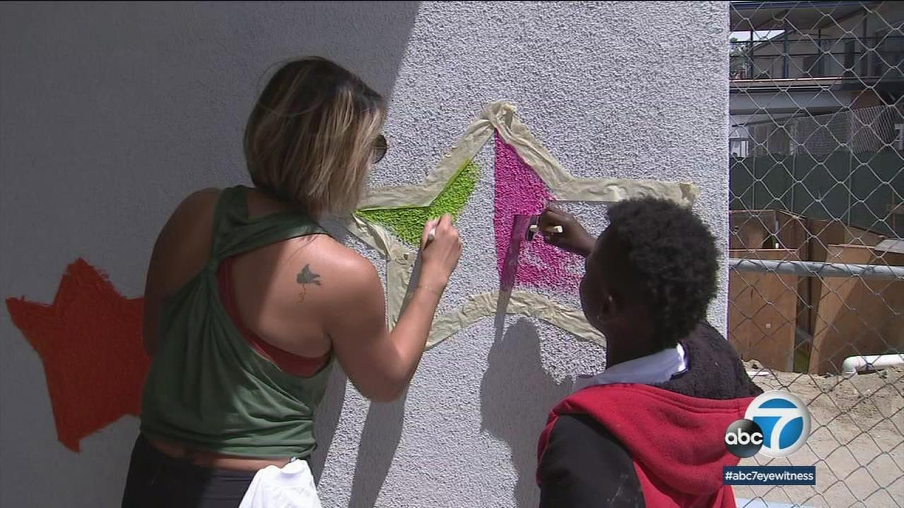 Volunteers painted stars and planted a garden at La Salle Elementary School in South LA for Big Sunday.