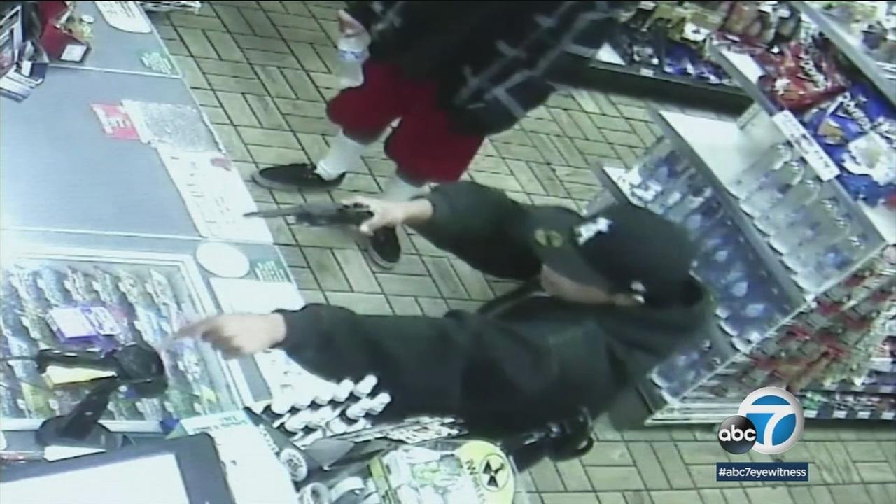 An armed robbery suspect is shown on surveillance video at a Garden Grove 7-Eleven.