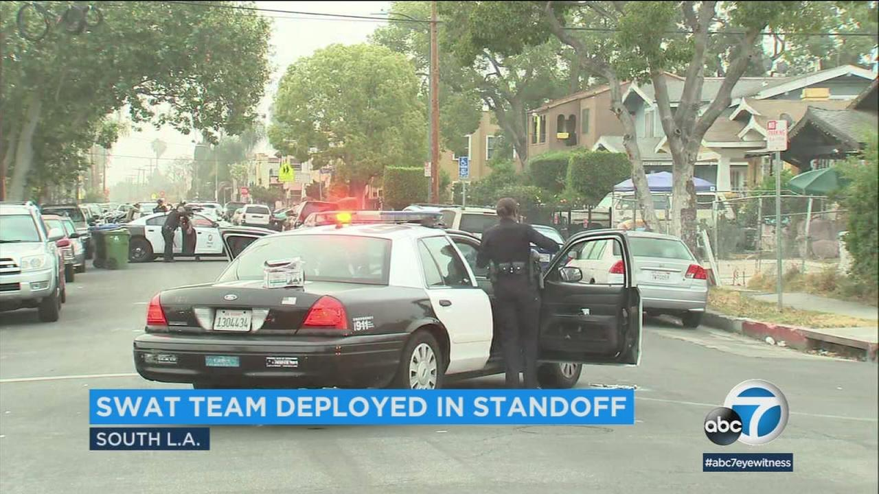 A gunman fired into the air before barricading himself inside a South Los Angeles apartment on Tuesday morning, prompting an hourslong standoff with police, authorities said.