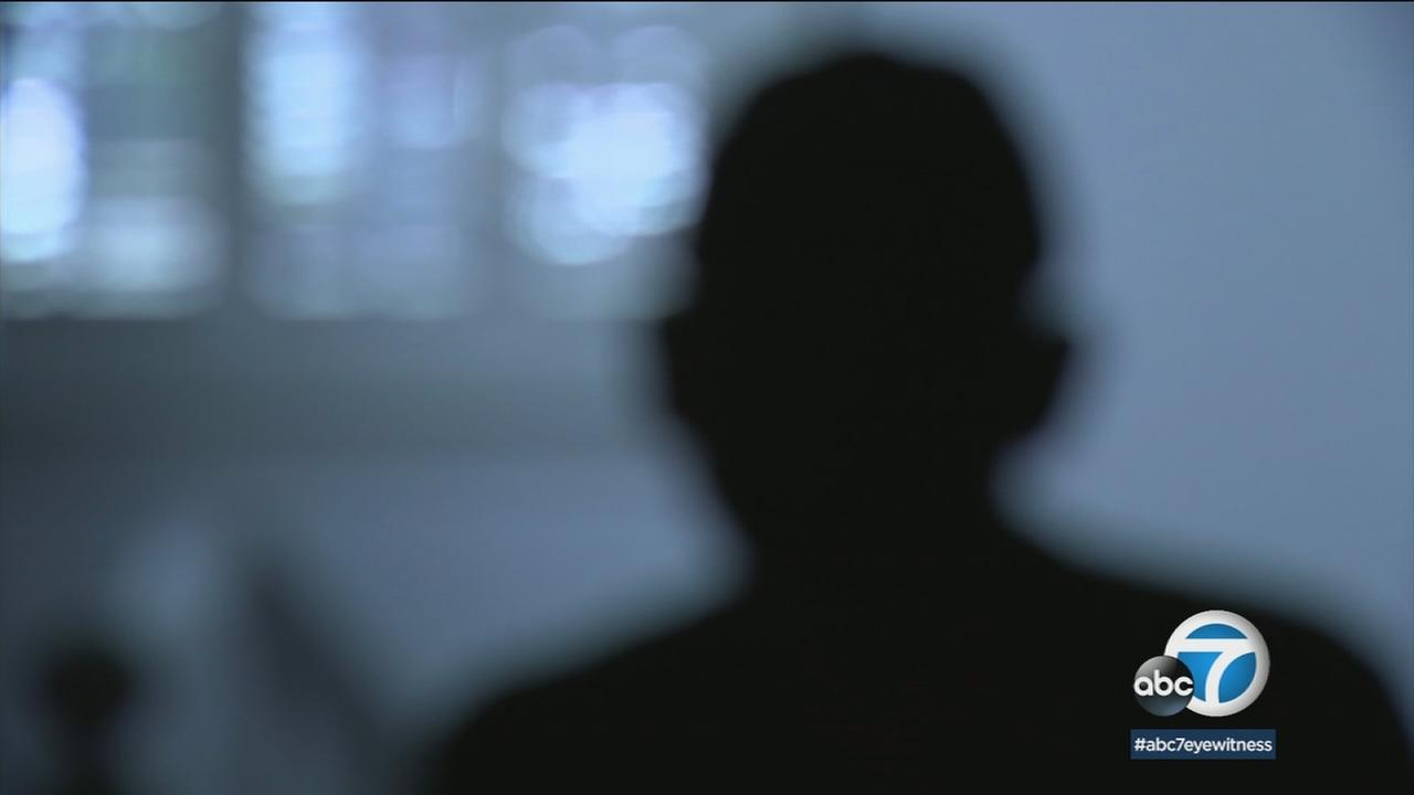 An LAPD informant is shown hidden in shadow during an interview.