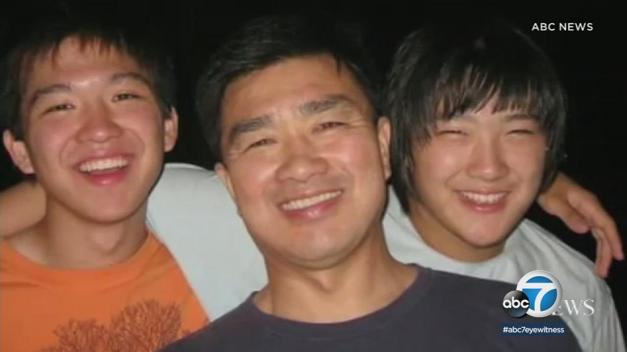 Tony Kim is shown with his two sons in an undated photo.