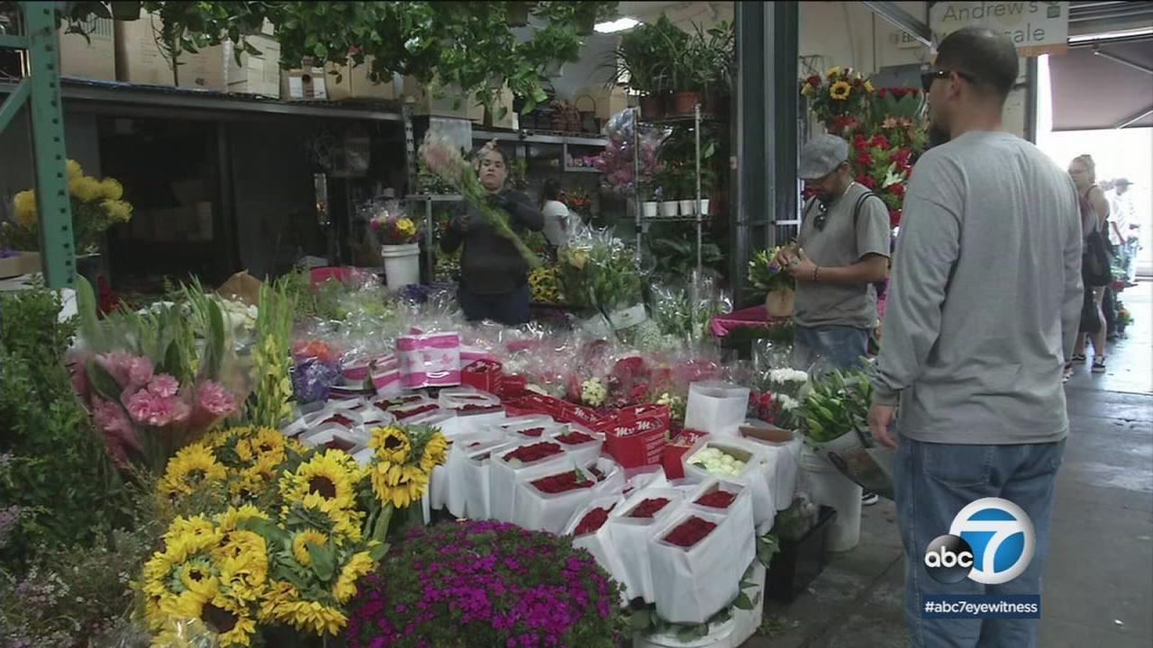 Customers buy flowers at downtown L.A.s Flower District for Mothers Day.