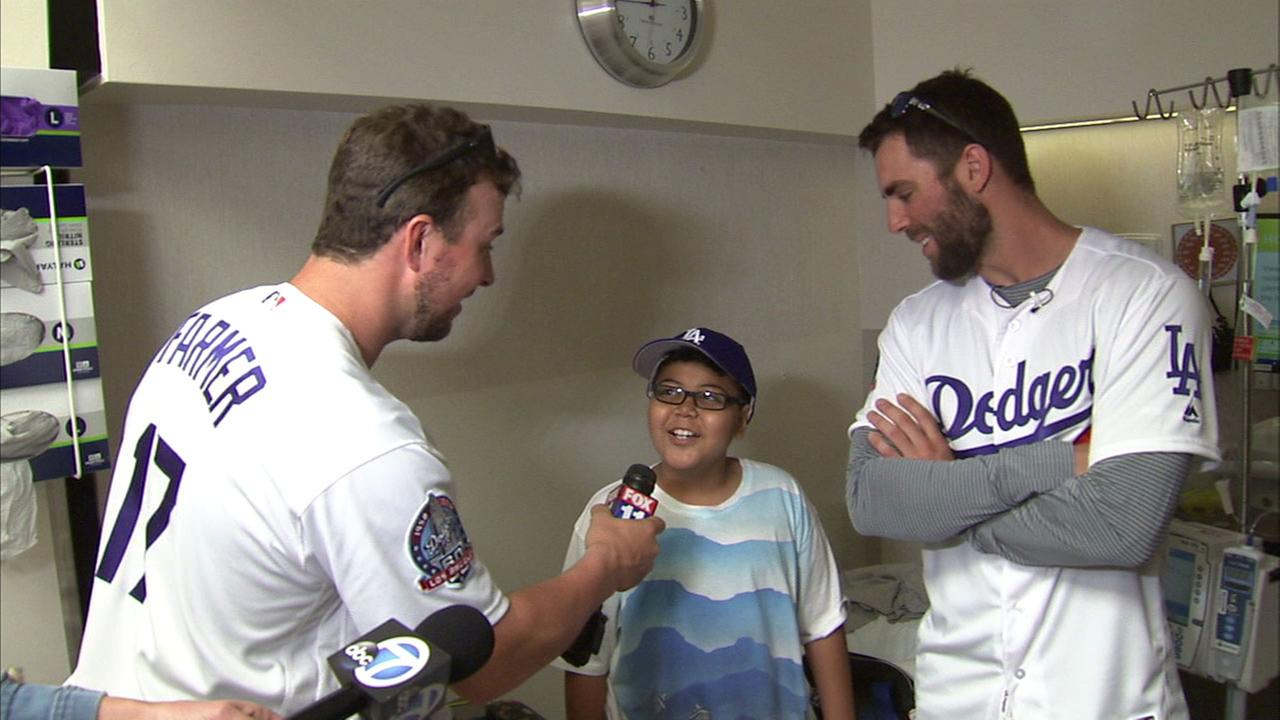 Los Angeles Dodgers Chris Taylor and  Kyle Farmer lifted spirits with their visit to the pediatric wing at Cedars-Sinai Medical Center on Thursday.