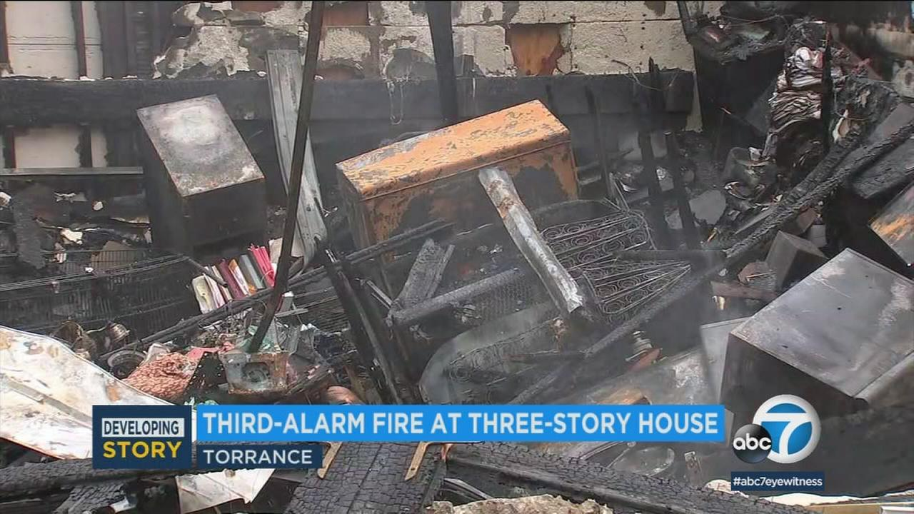 One person was hospitalized Saturday morning after a fire decimated a hillside home in Torrance, officials said.