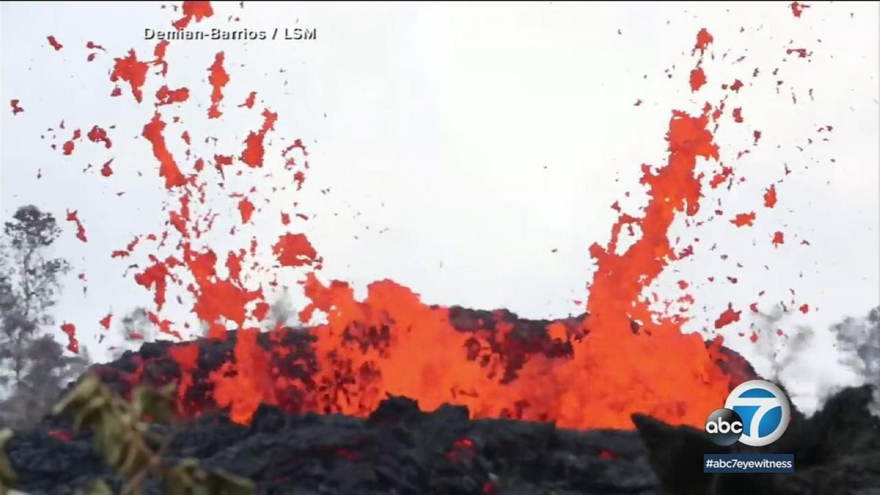 A new fissure emitting steam and lava spatter spurred Hawaii officials to call for more evacuations on Sunday as residents braced for an expected eruption from the Kilauea volcano.