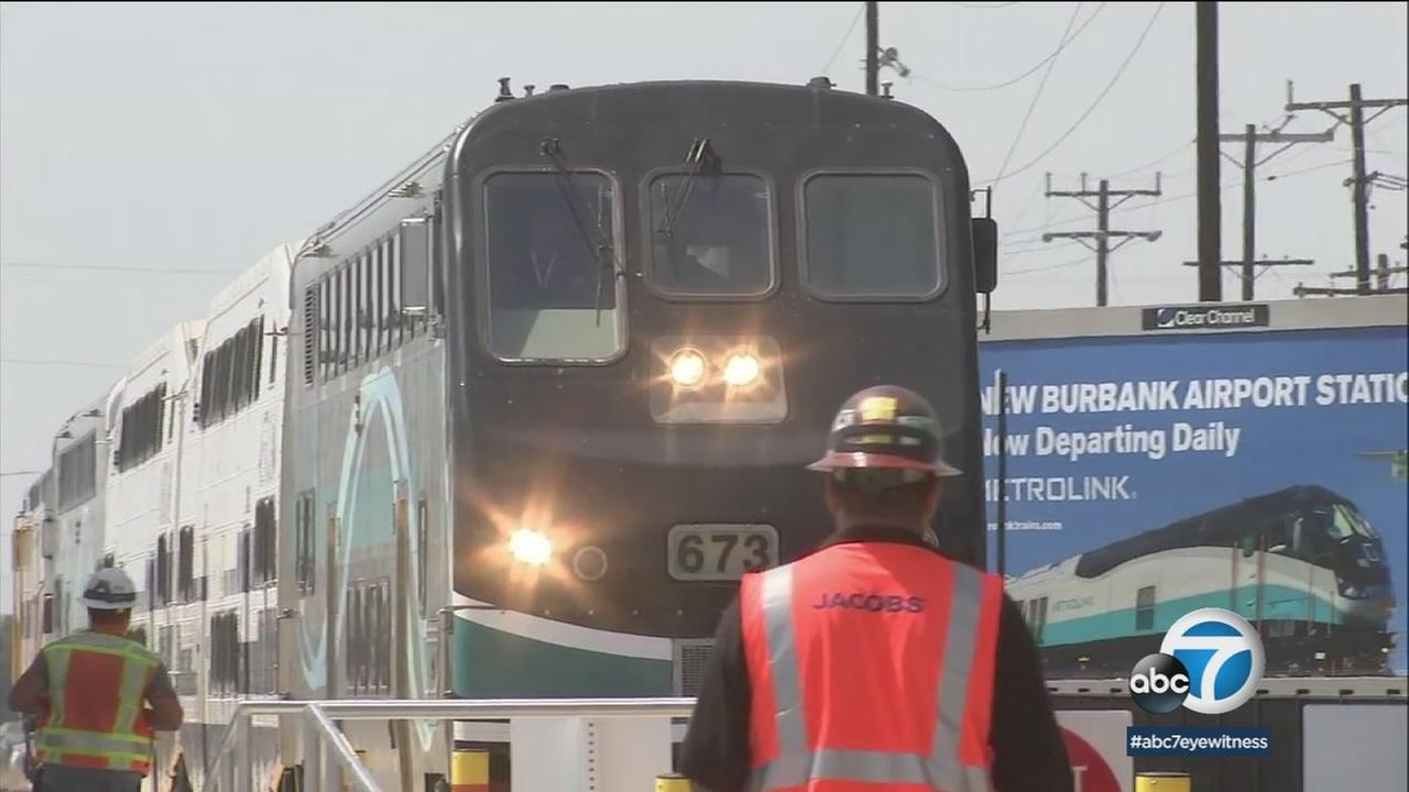 A Metrolink train is shown at the new station connecting the Antelope Valley with the San Fernando Valley and Hollywood-Burbank Airport.