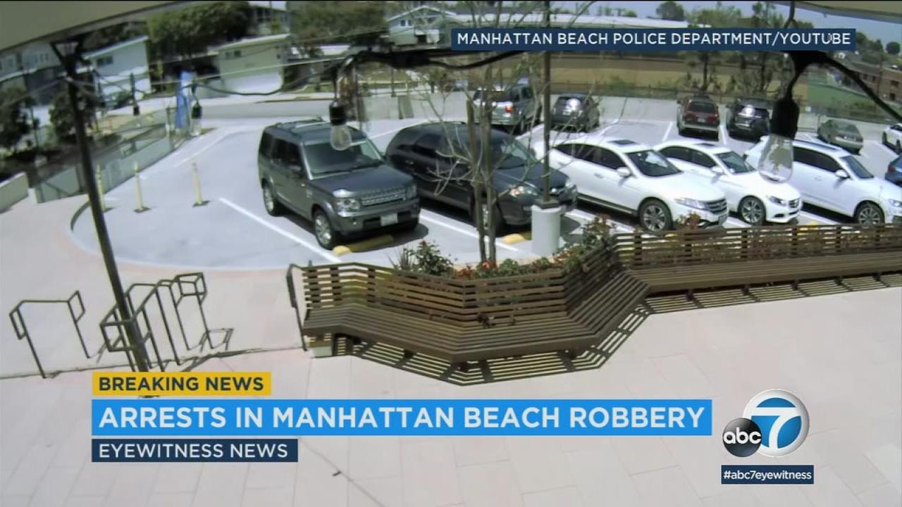 Two men are being charged with assault with a deadly weapon after allegedly taking part in a strong-arm robbery in a church parking lot in Manhattan Beach.