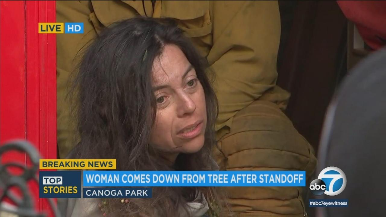A woman safely climbed down from a tree at a rec center in Canoga Park, bringing an 11-hour standoff to an end.