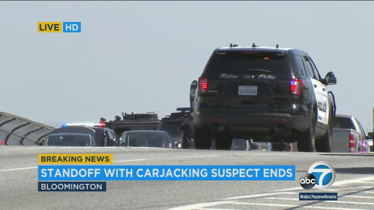 A stolen-car suspect was arrested after a car chase and three-hour standoff with authorities on a 10 Freeway overpass in Bloomington.