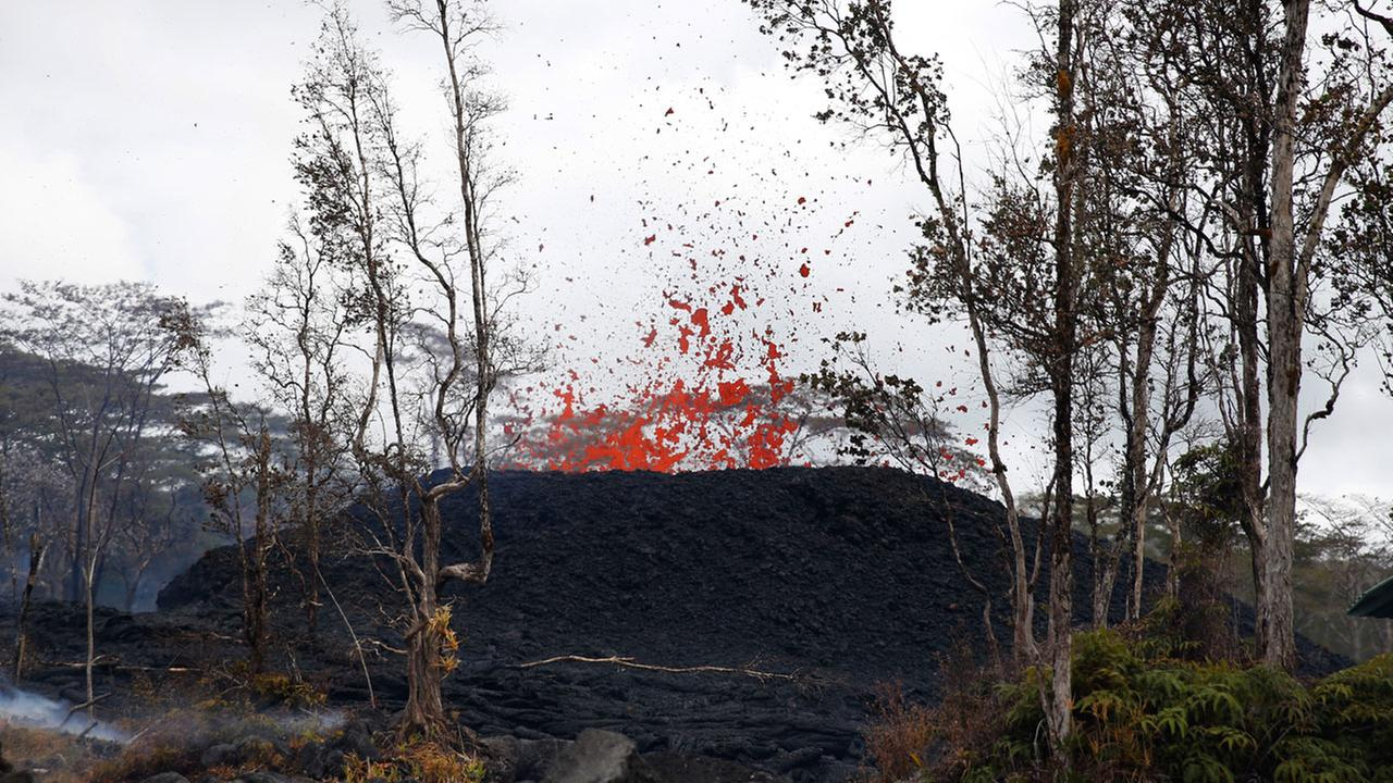 Lava shoots out of a fissure on Pohoiki Rd, Friday, May 18, 2018, near Pahoa, Hawaii.