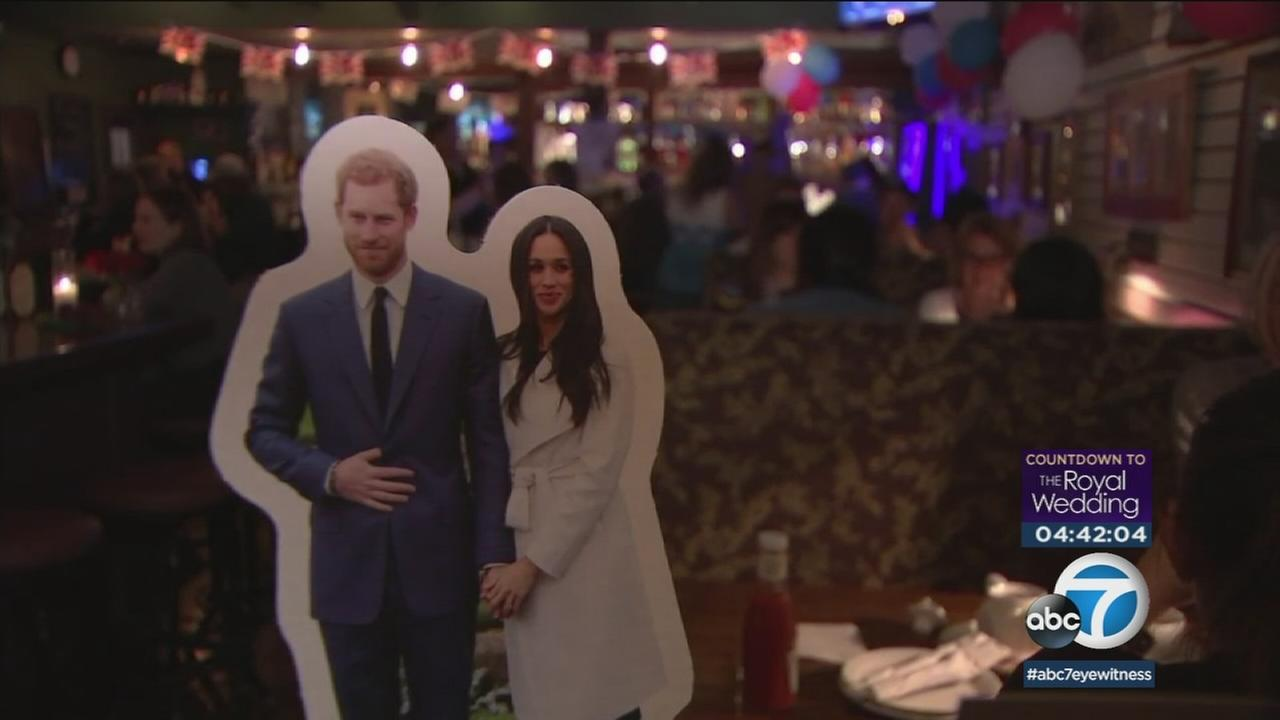 A photo of Prince Harry and Meghan Markle are shown in a cutout at the Cat and Fiddle Pub in Hollywood.