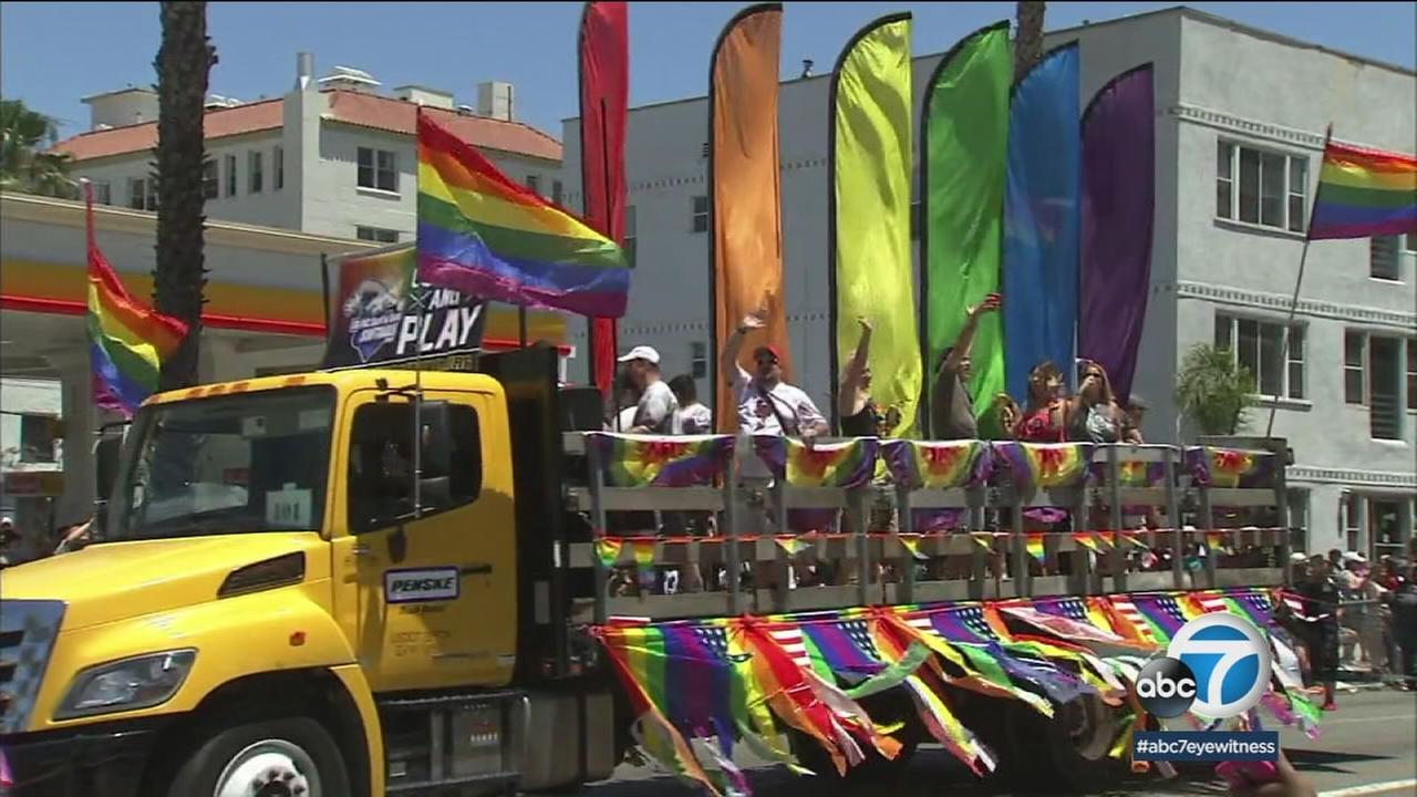 A float donned with rainbow flags and props is shown during the Long Beach Pride Parade.