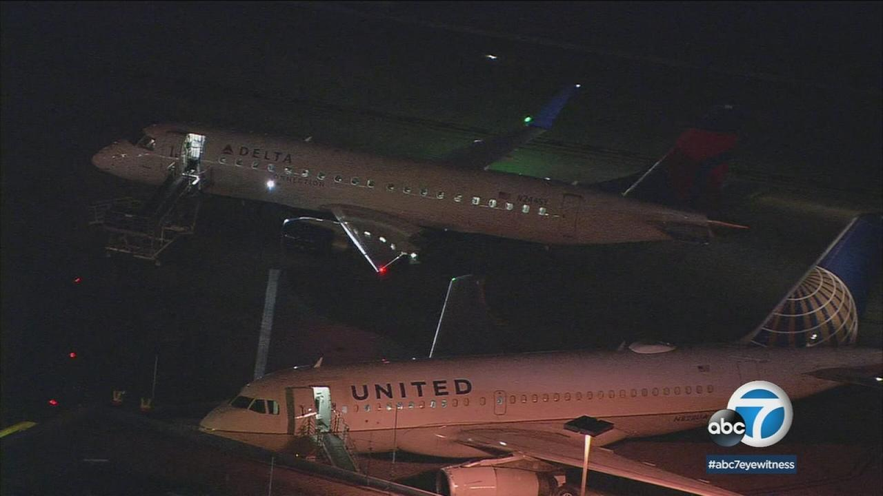 Two planes are shown on the tarmac of Hollywood-Burbank Airport after the wings of each flight clipped one another.